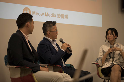 Lindsey Sun with guest at a Meow Media presentation